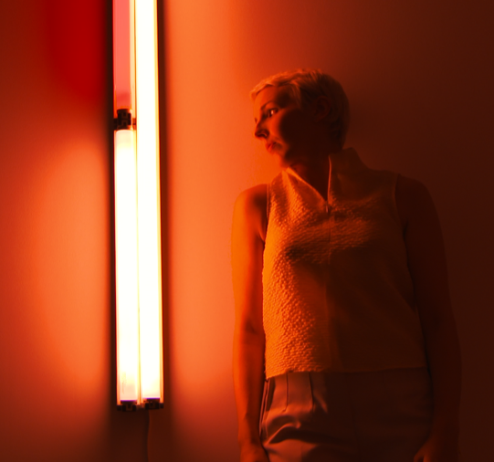 Megan Griffiths performs at BASTIAN Gallery in response to exhibition of Dan Flavin's work